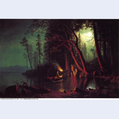 Lake tahoe spearing fish by torchlight