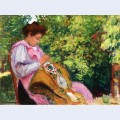 Girl embroidering seated in a garden