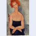 Redheaded woman wearing a pendant 1918
