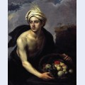 A young man with a basket of fruit