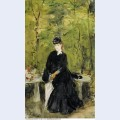 Young lady seated on a bench