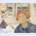 Girl and lamp in a cornish window