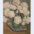 White peonies in green vase