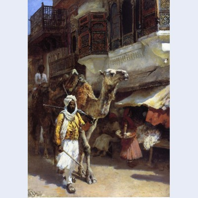 Man leading a camel
