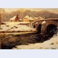 A stone bridge over a stream in winter