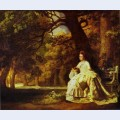 Lady reading in a wooded park
