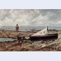 Der graue tag strand mit fischern und booten