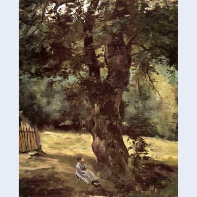 Woman seated beneath a tree