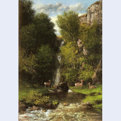 A family of deer in a landscape with a waterfall