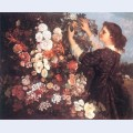 The trellis young woman arranging flowers