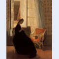 Woman sewing at a window