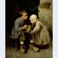 A boy feeding his younger sister