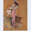 Dancer adjusting her tights 1890