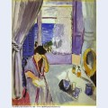 Woman reading at a dressing table interieur nice 1919