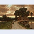 Figure on the road and farmhouse at sunset