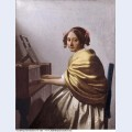 A young woman seated at the virginals a young woman seated at the virginal