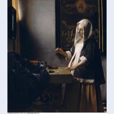 Woman holding a balance 1665