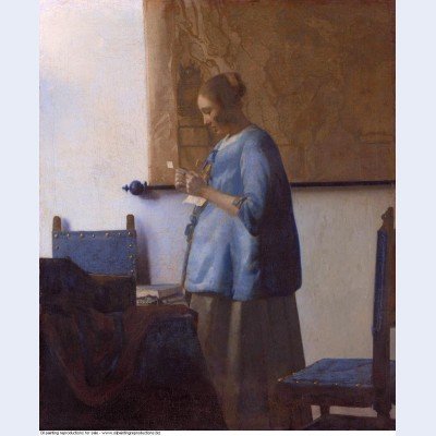 Woman reading a letter woman in blue reading a letter