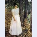 Autumn young woman in a garden