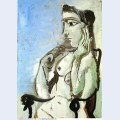 Female nude sitting in the armchair 1964