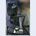 Seated woman with flat hat 1945