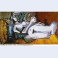 Femme nue couchee jouant avec un chat 4 1964
