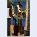 Guitare clarinette et bouteille sur une table 1916