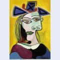 Tete de femme au chapeau bleu a ruban rouge 1939