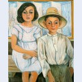 Girl sitting and boy with hat standing