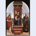 The madonna and child with st john the baptist and st nicholas of bari 1505