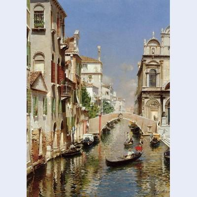 A venetian canal with the scuola grande di san marco and campo san giovanni e paolo venice