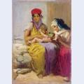 Young moorish woman nursing her child