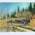 Orchard in blossom bordered by cypresses 1888 1